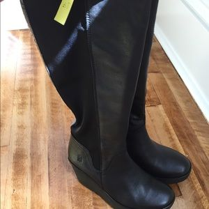 Black boots by Fly London
